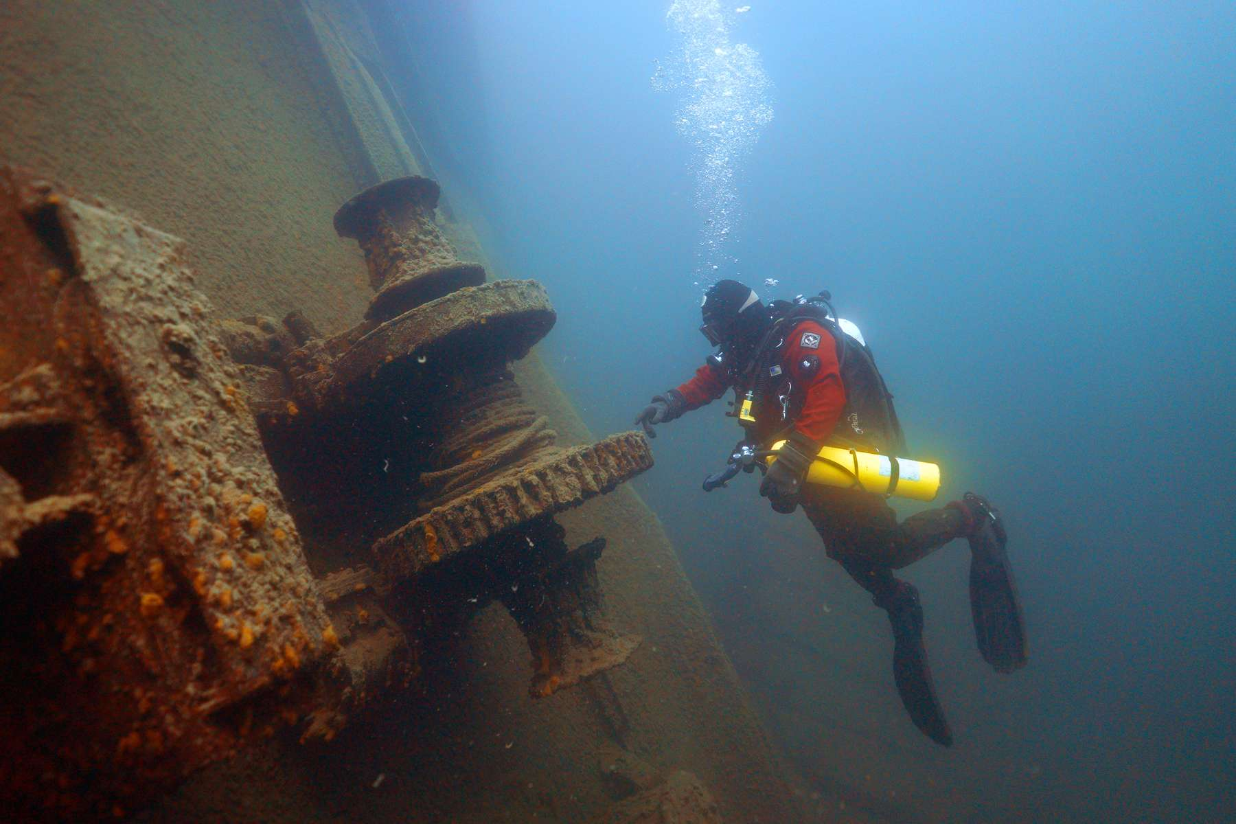 Jim Christenson, a diver with the Great Lakes Shipwreck Preservation Society, explored the stern winch on the Madeira, a schooner barge that sank in Lake Superior on November 28, 1905, at about 65 feet below the surface during a project dive near Split Rock Lighthouse south of Two Harbors, Minn.