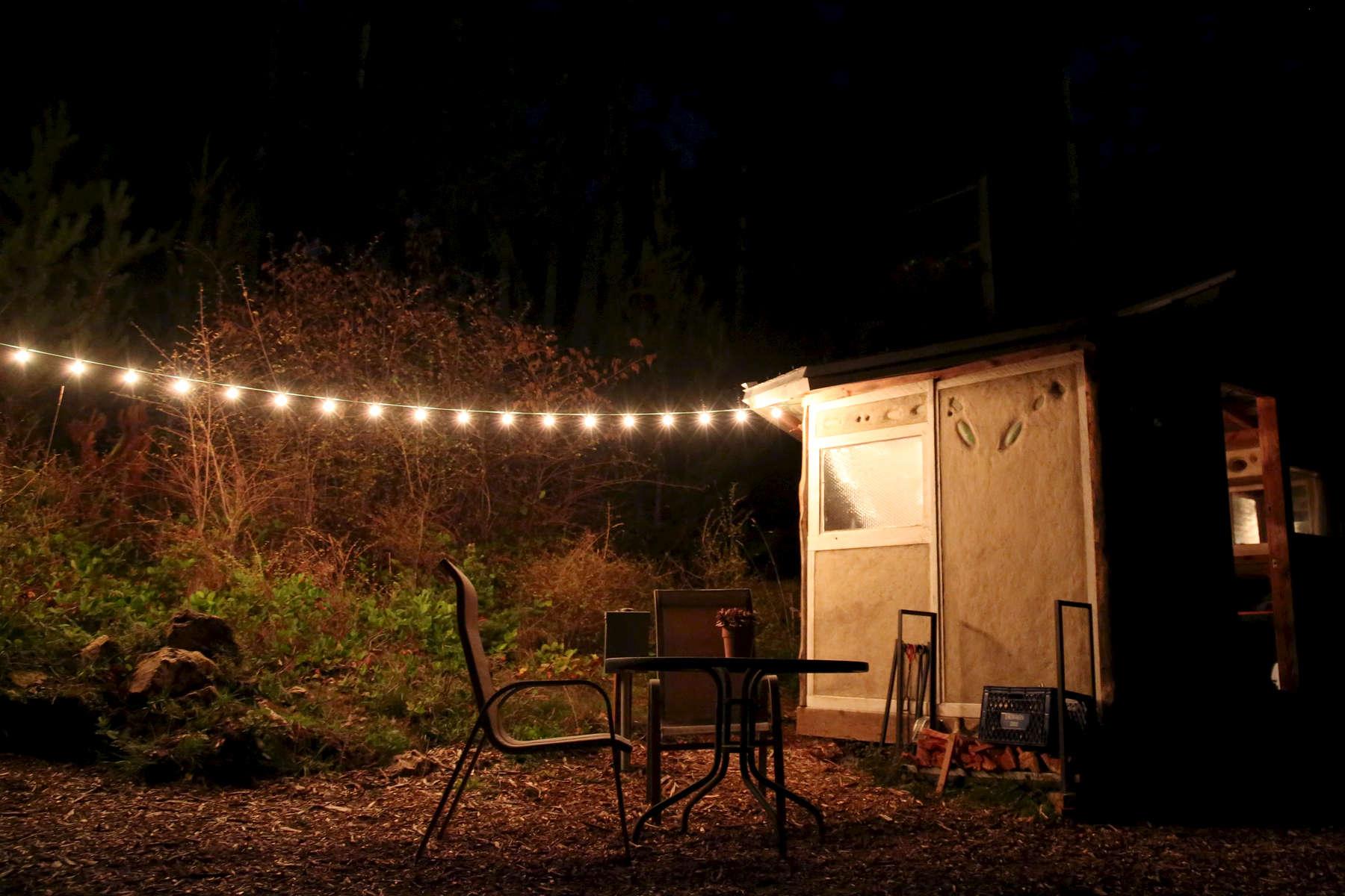 A string of lights illuminates a campsite on San Juan Island.