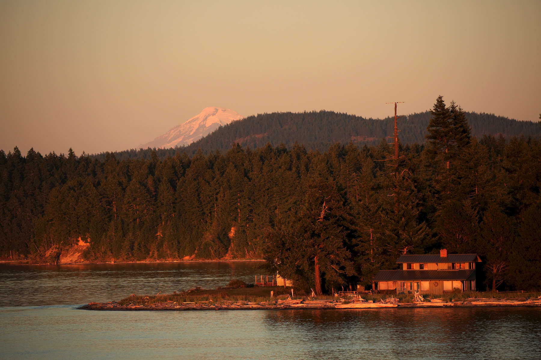 The setting sun illuminates a house on the ferry ride from Friday Harbor to Anacortes.