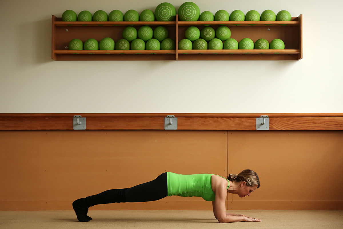 Jill Dailey McIntosh, founder of the Dailey Method barre workouts, holds a forearm plank during a yoga class at the Bucktown Dailey Method studio in Chicago.