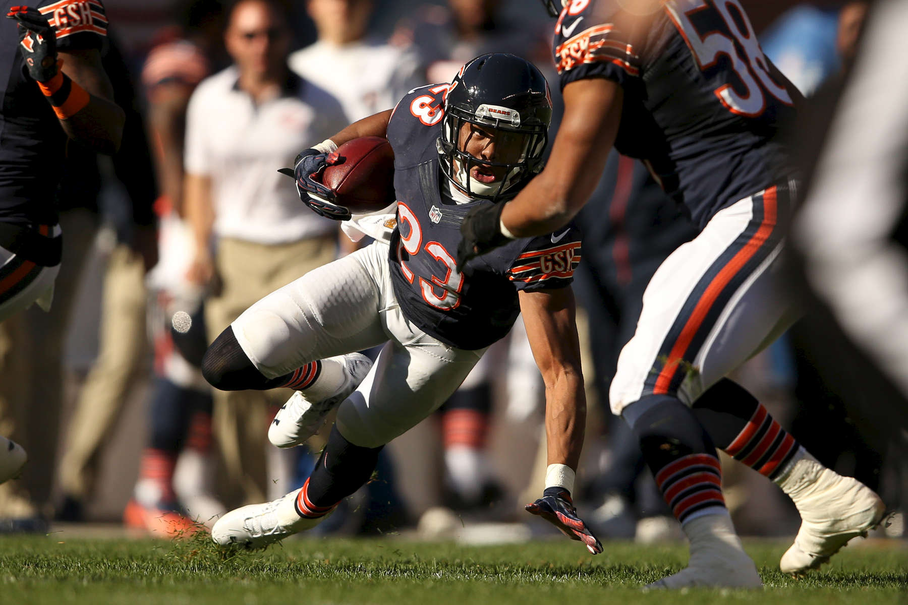 Chicago Bears cornerback Kyle Fuller looks up as he slips while trying to gain yards during the first half of an NFL game between the Chicago Bears and the Minnesota Vikings at Soldier Field in Chicago.