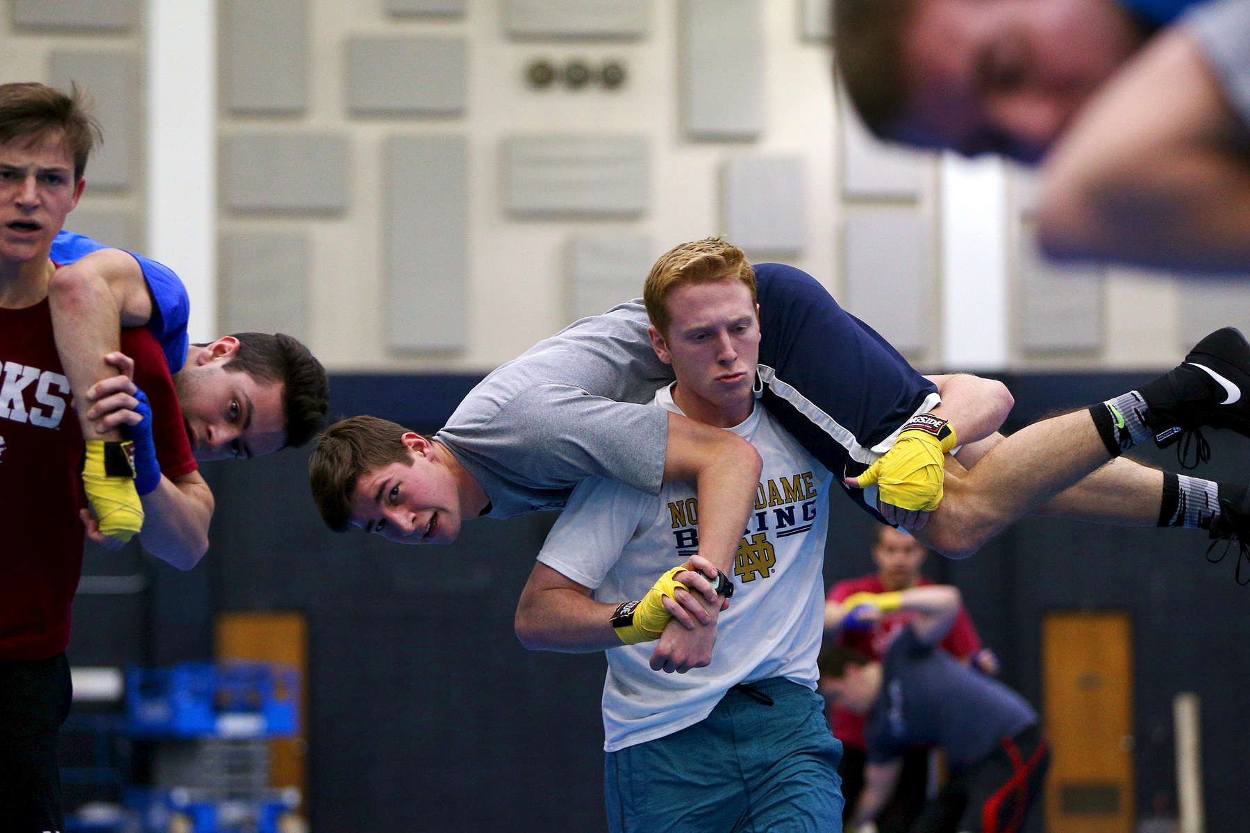 Sean Himel, at center, is carried by a fellow student as they participate in a practice for the Bengal Bouts, an annual charity boxing tournament hosted by the men's Boxing Club at the University of Notre Dame at the university's Joyce Athletic Center in Notre Dame, Ind. Proceeds from the event go to the Holy Cross Missions in Bangladesh.
