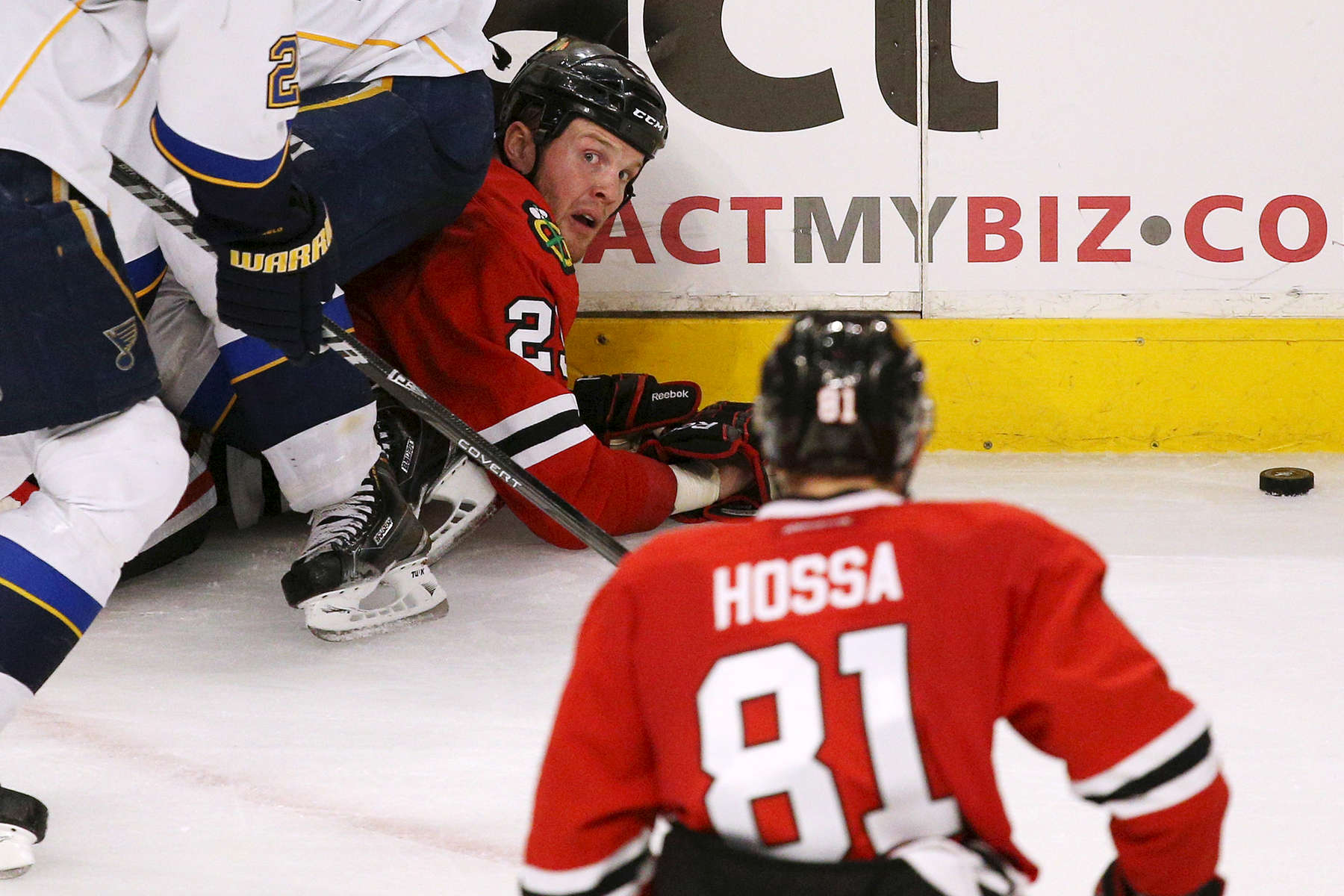 Chicago Blackhawks left wing Bryan Bickell looks up at right wing Marián Hossa after getting tangled with St. Louis Blues left wing Alexander Steen in the third period during Game 6 of a Western Conference quarterfinal playoff game between the Chicago Blackhawks and the St. Louis Blues at the United Center in Chicago.