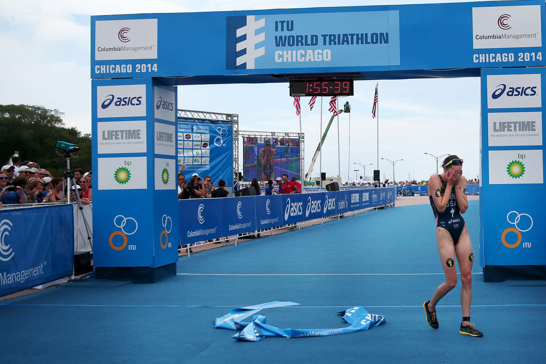 The United States' Gwen Jorgensen buries her face in her hands after winning the International Triathlon Union's (ITU) World Triathlon Chicago at Grant Park in Chicago.