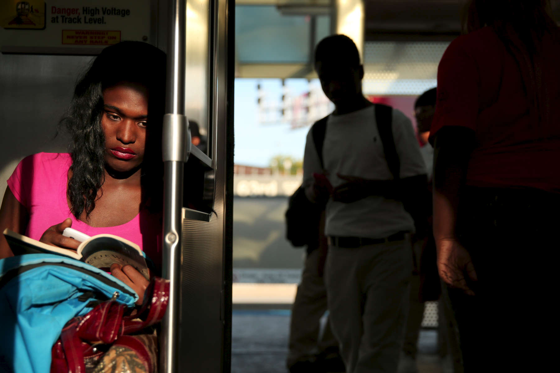 Former Lawrence Hall Youth Services resident Keyona Laws rides the CTA red line train to see a friend in Chicago. Laws, a transgendered person, was severely abused while in foster care as a child before being sent to live at Lawrence hall where she would often run away and resort to prostitution for money.