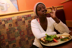 Meisha Singleton, a former resident of Indian Oaks Academy, eats after bartering for dinner at a Panera Bread Co. in Chicago. While living at Indian Oaks Academy Singleton was a frequent runaway.