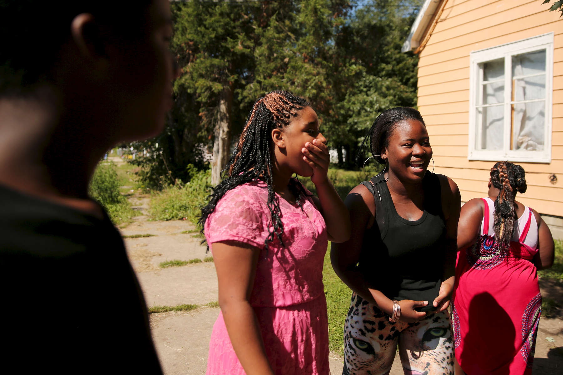 Cleanna Parker-Lewis, a former resident of Rock River Academy, at right, laughs with her cousins in Peoria, Ill. The state Department of Children and Family Services took protective custody of her when she was 6 months old, following abuse and neglect allegations.