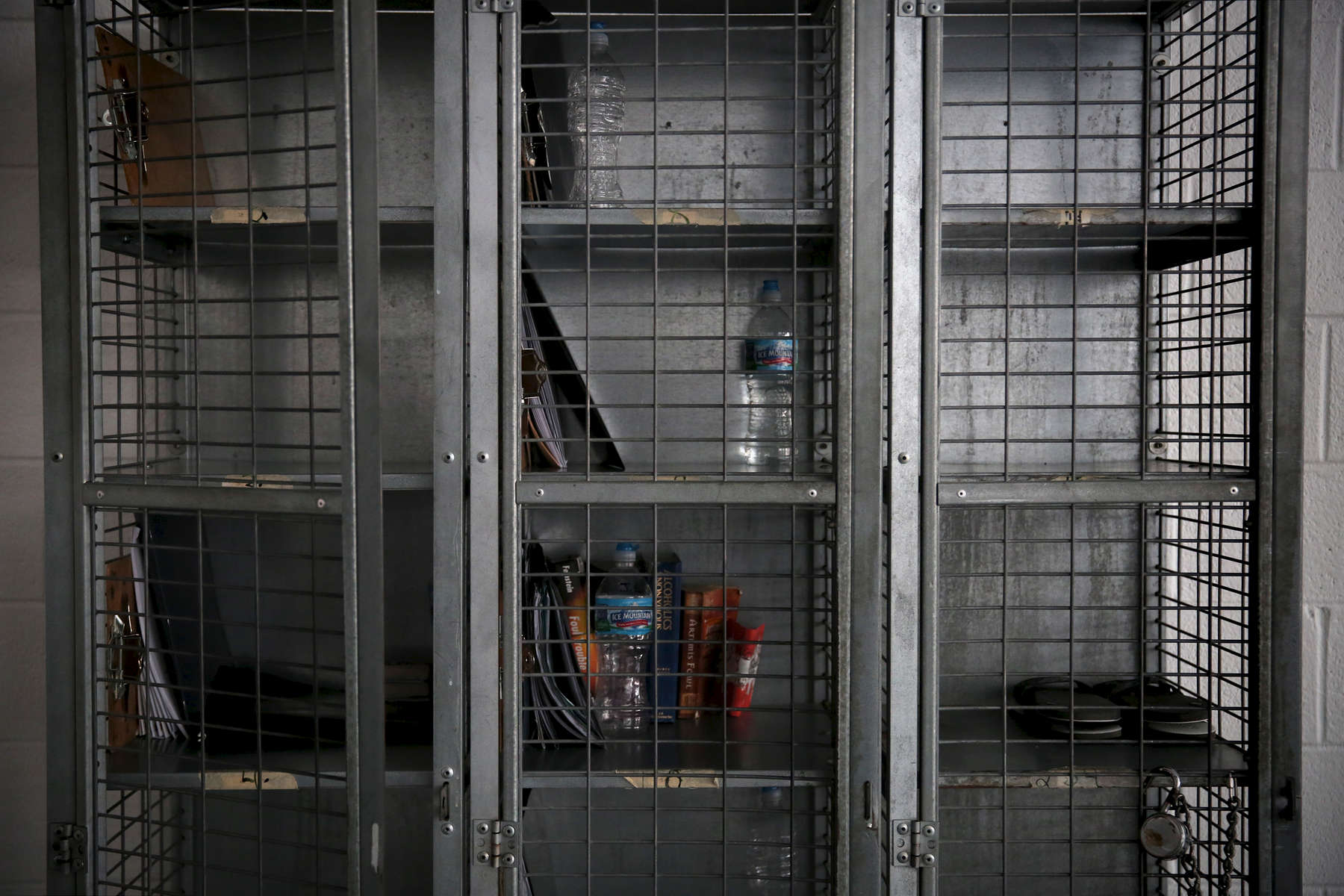 A wire locker sits in one of the boys' living quarters at Wolverine Human Services in Vassar, Mich. At night the residents' sneakers are locked up here to discourage running away.