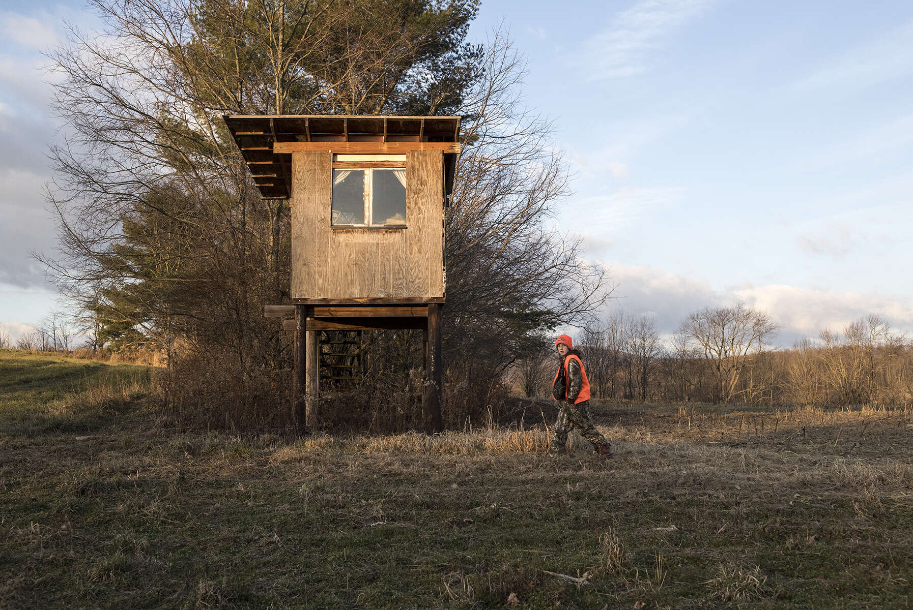 Ethan Cole, age 11, returns to the tree stand after searching with his father for a deer he shot while hunting on opening day of deer rifle hunting season in Troy, Penn., on Monday, November 27, 2017. Ethan is enrolled in the Mentored Youth Hunting Permit program and can hunt with a licensed adult mentor, but the gun must be carried by the adult and only one gun may be used between the pair. He went hunting with his father on opening day. The deer he shot was not found, leaving them to believe he just grazed it and it was not mortally wounded.