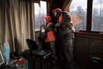 Ethan Cole, age 11, looks for deer out of the window of a tree stand on his family's dairy farm while hunting with his father Toby Cole on opening day of deer rifle hunting season in Troy, Penn., on Monday, November 27, 2017. Deer hunting is such an important part of the culture in this part of rural Pennsylvania that the Troy Area School District cancels school the first two days of deer rifle season so children can hunt with their families. Ethan is enrolled in the Mentored Youth Hunting Permit program and can hunt with a licensed adult mentor, but the gun must be carried by the adult and only one gun may be used between the pair.