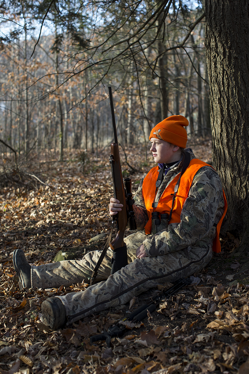 Meredith Cole, age 13, looks out for deer in the woods on her family's dairy farm on opening day of deer rifle hunting season in Troy, Penn., on Monday, November 27, 2017. Deer hunting is such an important part of the culture in this part of rural Pennsylvania that the Troy Area School District cancels school the first two days of deer rifle season so children can hunt with their families. Meredith is over the age of 12 and has passed a hunter safety course and is therefore allowed to hunt while carrying her own gun as long as she is in the presence of a licensed adult.