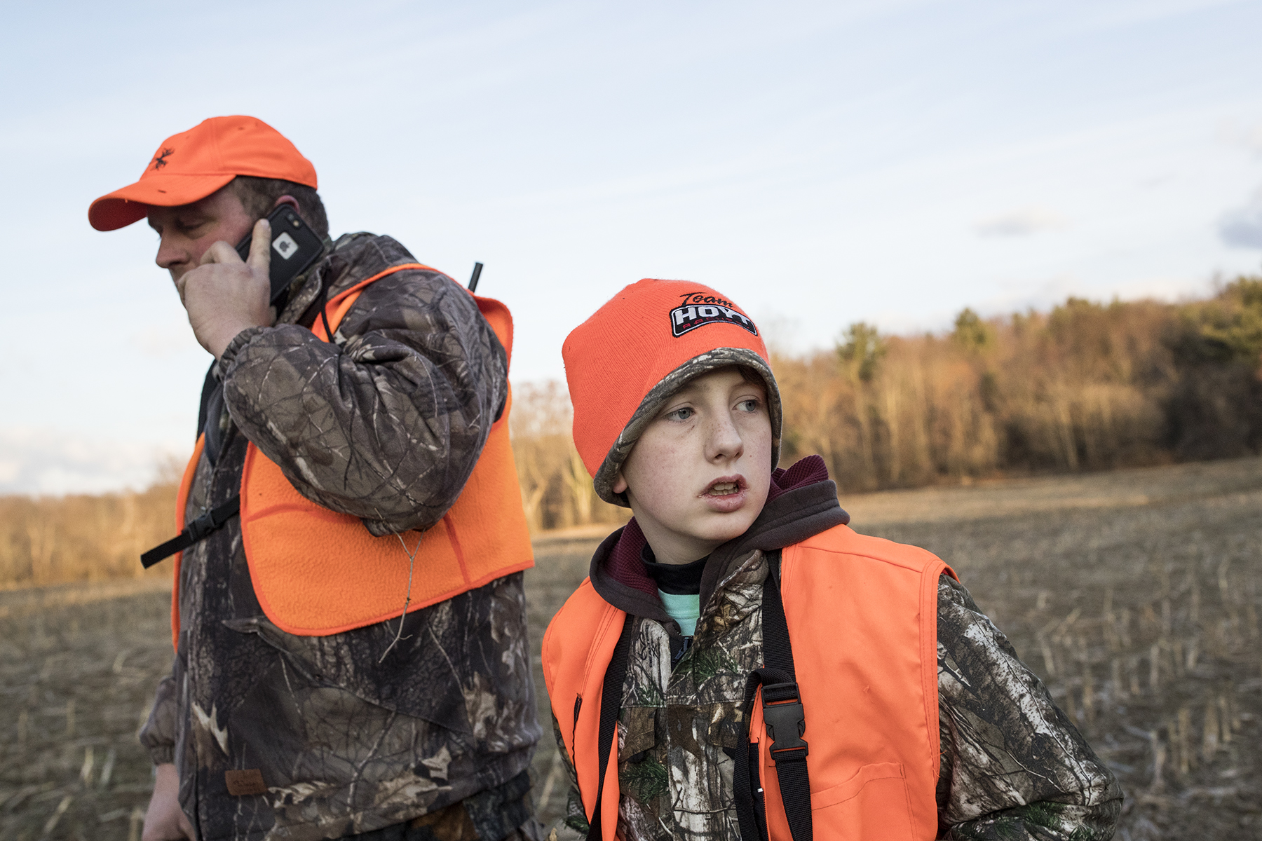 Ethan Cole, age 11, and his father Toby Cole walk through a field on their family's dairy farm after searching for a deer Ethan shot while hunting on opening day of deer rifle hunting season in Troy, Penn., on Monday, November 27, 2017. Ethan is enrolled in the Mentored Youth Hunting Permit program and can hunt with a licensed adult mentor, but the gun must be carried by the adult and only one gun may be used between the pair. He went hunting with his father on opening day. The deer he shot was not found, leaving them to believe he just grazed it and it was not mortally wounded.