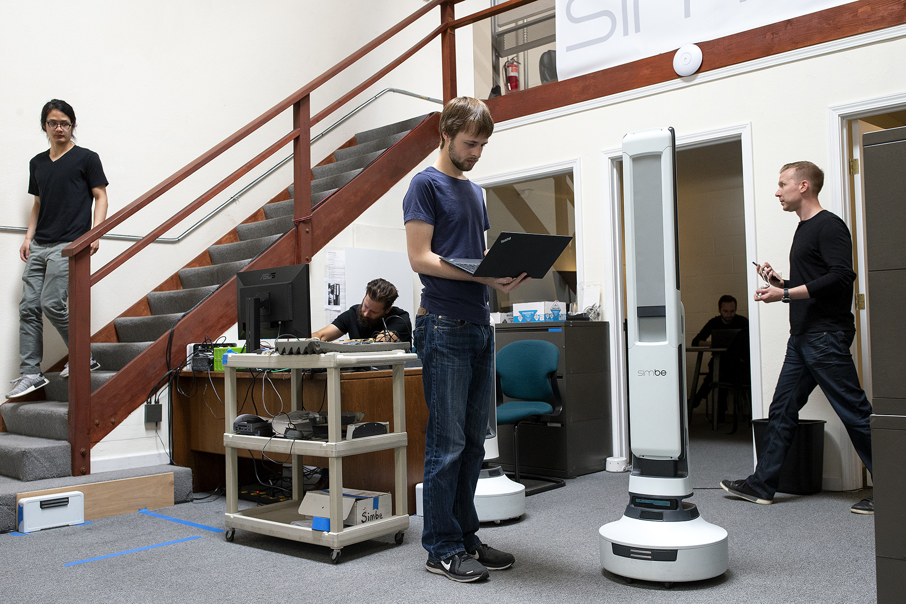Senior robotics engineer Steven Macenski works on robot perception with the Tally robot at the headquarters of Simbe Robotics in San Francisco, Calif., on Thursday, June 28, 2018. The company makes Tally, a fully autonomous shelf-auditing and analytics robot for retail goods. Tally uses computer vision capabilities to audit shelves for out-of-stock items, low stock items, misplaced items and pricing errors and is designed to due so while operating alongside shoppers and employees. CONTACTS:Steven Macenski – senior robotics engineer – focused on robot behavior stevenmacenski@gmail.com224-343-3533