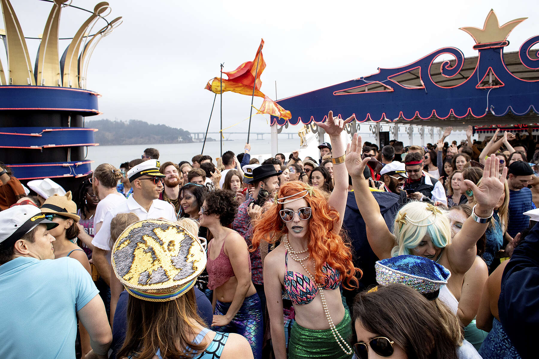 Daybreaker attendees dance during the event on the Hornblower Belle cruise ship, which celebrated the 4th anniversary of the early-morning dance parties in San Francisco, Calif., on Friday, July 20, 2018. Attendees were encouraged to dress in a nautical theme. Daybreaker describes itself as {quote}an early morning dance movement.{quote} The parties are alcohol and substance free, held early in the morning on the weekdays. The dance parties start at 7 am and are supposed to help energize attendees before they head to work and the day ahead. CONTACTS: Organizer: Mustafa Khan hey.mustafa@gmail.com