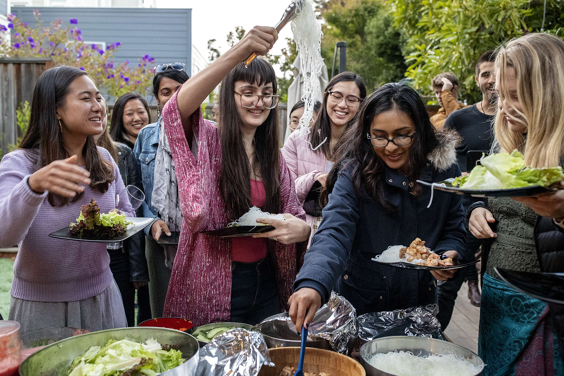 Violet Society members Lucille Zhao, Michelle Galemmo, Samanee Mahbub and  Amanda Crosby Rickman (left to right) help themselves to the meal during a dinner hosted for the organization at the office of the equity crowdfunding platform Wefunder  in San Francisco, Calif., on Wednesday, August 8, 2018. Wefunder lobbied congress to legalize equity crowdfunding, allowing privately held companies to raise investment from everyday people, so-called unaccredited investors. Regulation Crowdfunding began on May 16, 2016.  The company regular hosts dinner parties for members of the tech community at their office, which also serves as the home of a few employees. The Violet Society, described as a {quote}startup sisterhood,{quote} is a 12-week part-time summer program for young women in the tech industry who want to build startups. CONTACTS: Nick Tomatello Wefunder CEOnick@wefunder.com508-308-7226Shriya Nevatia Violet Society founderSneva831@gmail.com518-338-8505Michelle Galemmomgalemmo@gmail.com267-625-6141Samanee Mahbubsamaneezm@gmail.com401-286-0663Lucille ZhaoLucille.zhao@gmail.com312-866-7366Amanda Crosby Rickmanacrosbyrickman@gmail.com510-359-2397