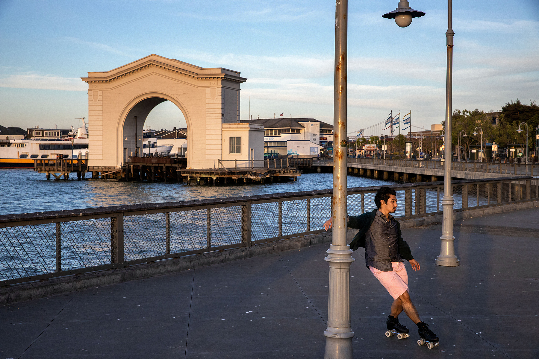 Ali White (pink outfit/blue helmet) and Joshua Ugarte (pink shorts) roller skate in Fisherman's Wharf behind the closed Franciscan Crab Restaurant in San Francisco, Calif., on Friday, May 15, 2020. The city is still under shelter-in-place orders due to the Covid-19 virus, but residents are allowed outside for exercise and essential activities. White is a school teacher who took up roller skating only a few weeks ago to relax and Ugarte used to be a figure skater.