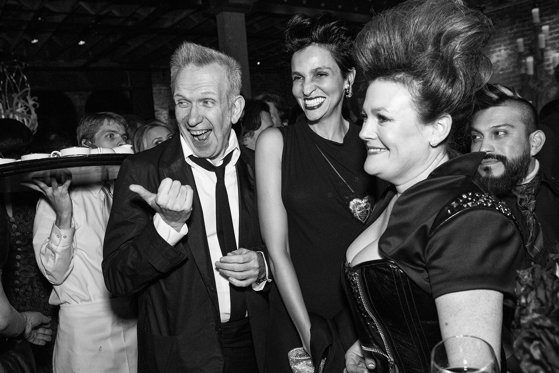 Fashion designer Jean Paul Gaultier, his muse and former model Farida Khelfa and society columnist Jennifer Raiser (left to right) enjoy a private party in Gaultier's honor to celebrate the opening of an exhibit of his work at the de Young Museum in San Francisco, Calif., on Thursday, March 22, 2012.This photograph is of a candid moment and was not directed in any way.