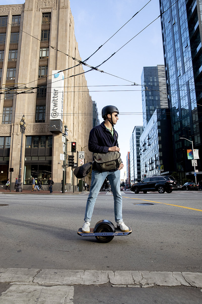 A commuter riding a Onewheel electronic skateboard passes by the building that houses the headquarters of Twitter, located in the Mid-Market neighborhood, in San Francisco, Calif., on September 21, 2018. In 2011 San Francisco passed the controversial Central Market Tax Exclusion to encourage companies to move into the Mid-Market and Tenderloin neighborhoods. Tech giants such as Twitter, Dolby and Uber are now located in the area.