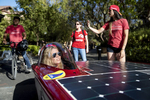 Maggie Ford, engineering director of the Stanford Solar Car Project, demos a solar car with her team at a September activities fair at Stanford University in Stanford, Calif., on September 28, 2018. Every two years, the student team designs, builds and races a solar car in the Bridgestone World Solar Challenge across the Australian Outback. Stanford University has had a large influence on the development of Silicon Valley.