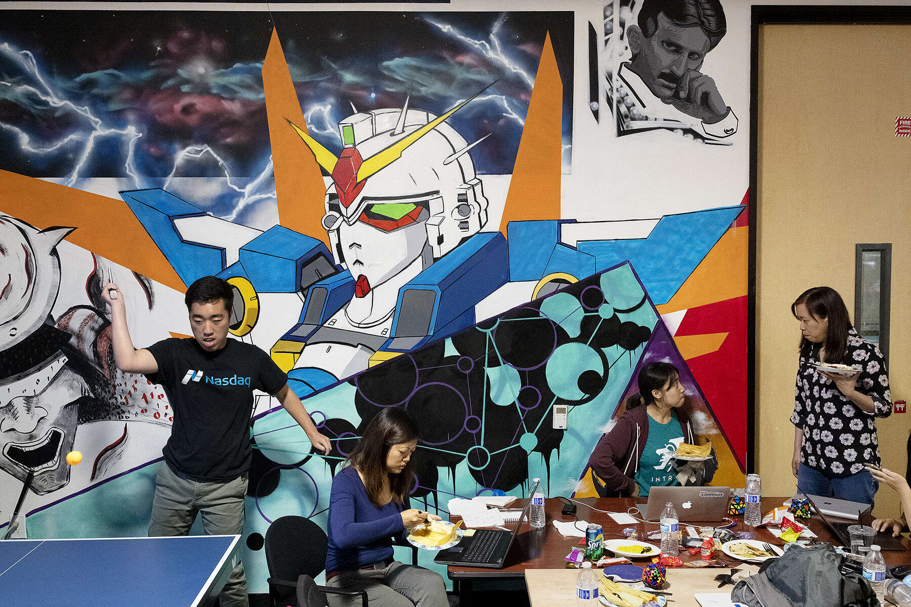 Computer science student and frequent hacker Danny Hyun Cho (left) takes a Ping-Pong break while working on a project with his team at AT&T's Entertainment Hackathon at Hacker Dojo in Santa Clara, Calif., on July 28, 2018. Hacker Dojo is a community center and hacker space for those interested in technology.