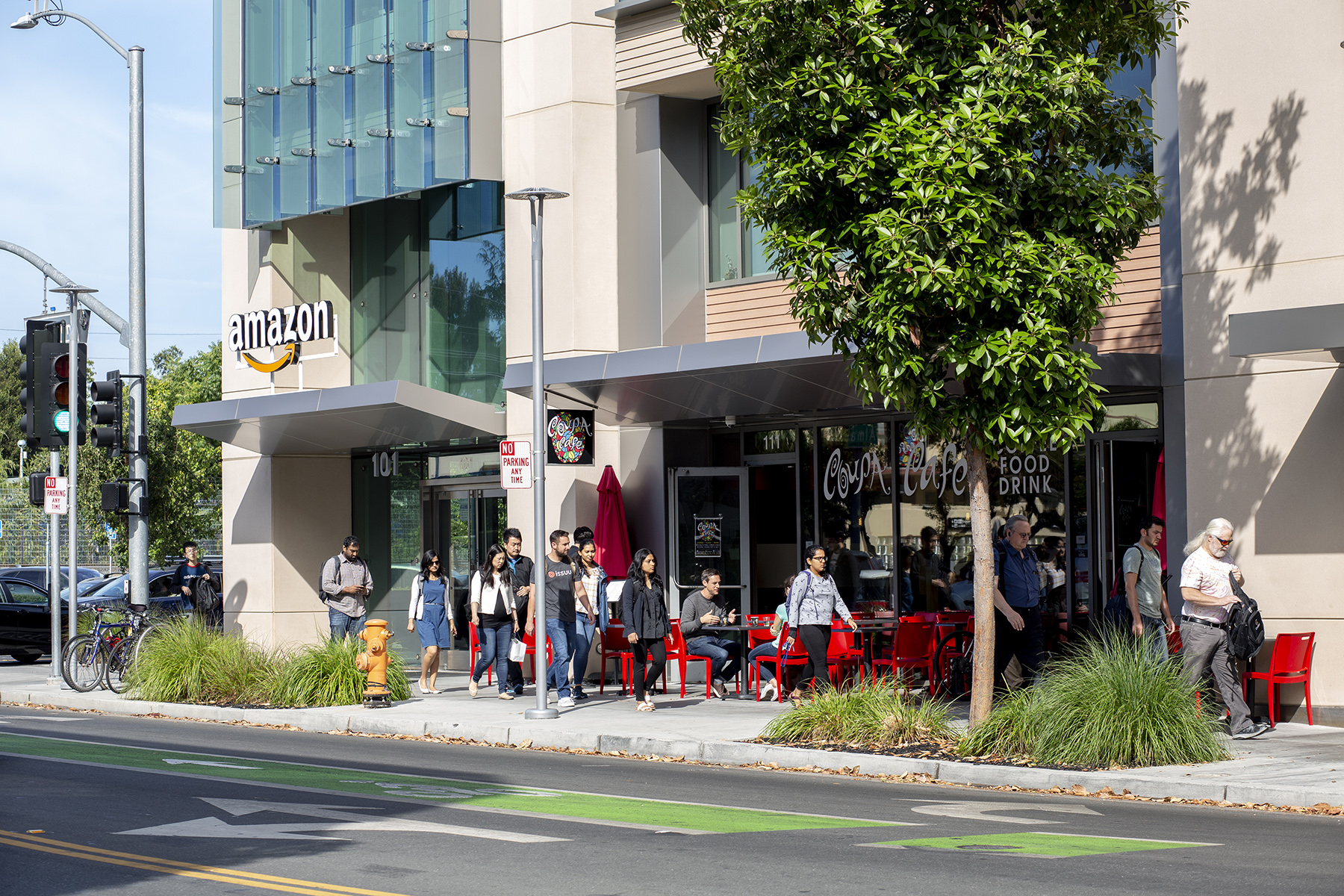 An office building used by technology giant Amazon is seen, with a bustling cafe on the building's street level, in Palo Alto, Calif., on June 24, 2019. The company is based in Seattle, but has workers spread out across several Silicon Valley cities.