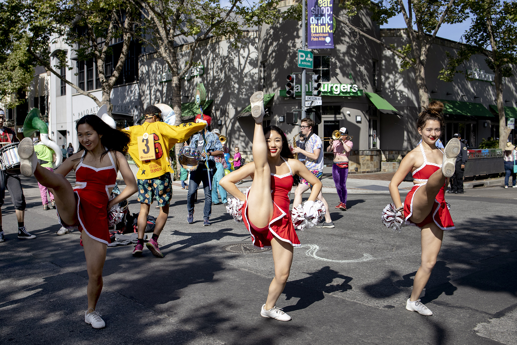 The Stanford Cheerleading Squad rehearses before performing during the 97th annual May Fete Parade, a major town event, on University Avenue in Palo Alto, Calif., on May 4, 2019.