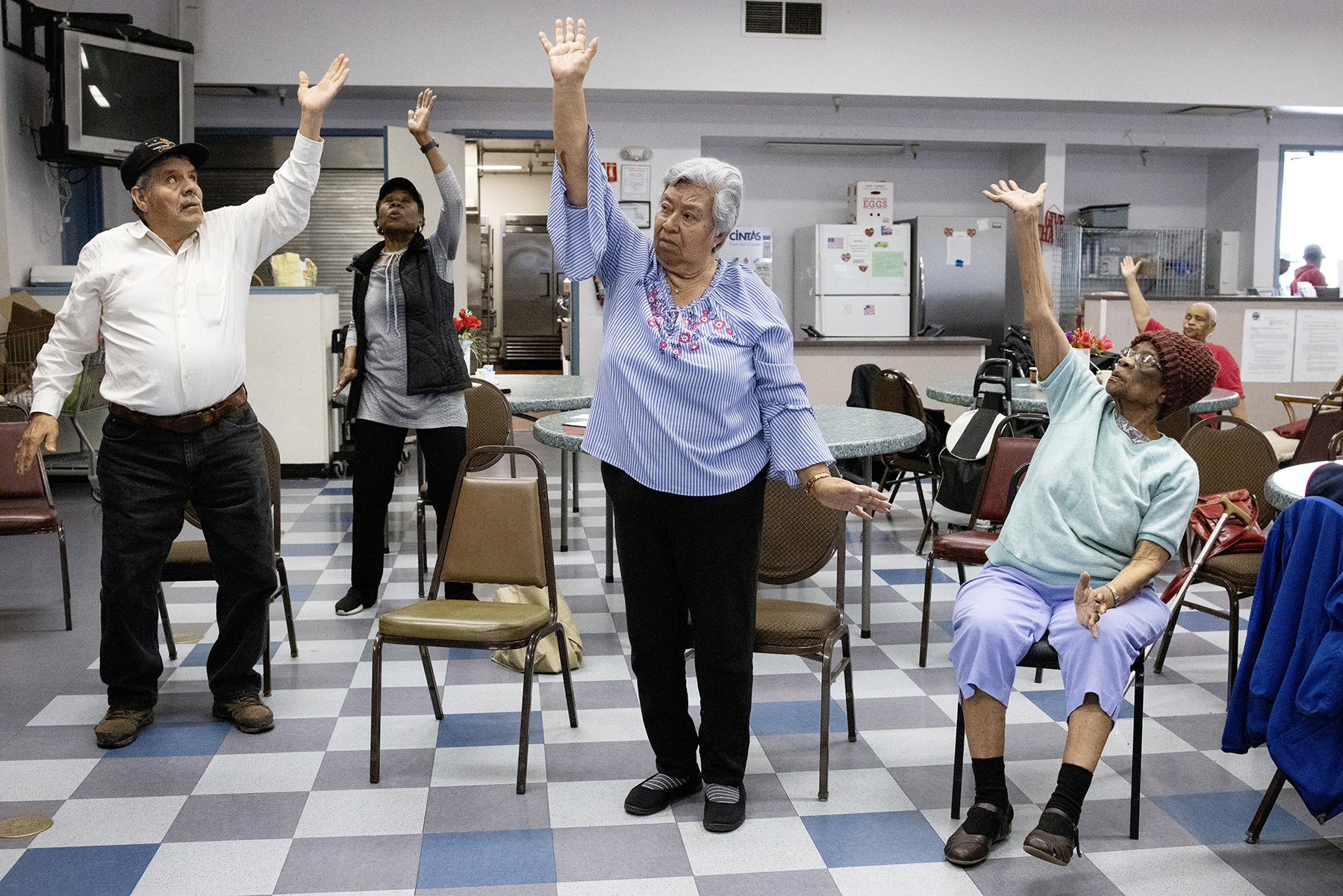 Seniors take a Tai Chi class at the East Palo Alto Senior Center in East Palo Alto, Calif., on April 17, 2019. The center, which serves as a community gathering place for seniors in the city, has a variety of activities and also serves affordable meals. This is an important asset in the community especially since East Palo Alto, once a relatively affordable city in Silicon Valley, is facing rising housing costs and gentrification due to its close proximity to the corporate headquarters of large technology companies.