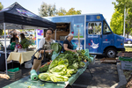 Shoppers pick up produce at a farmer's market sponsored by Facebook Community Events in East Palo Alto, Calif., on June 2, 2019. The farmer's market, which moves among three different locations on Sundays, has produce and other items, which are subsidized and sold at reduced prices.