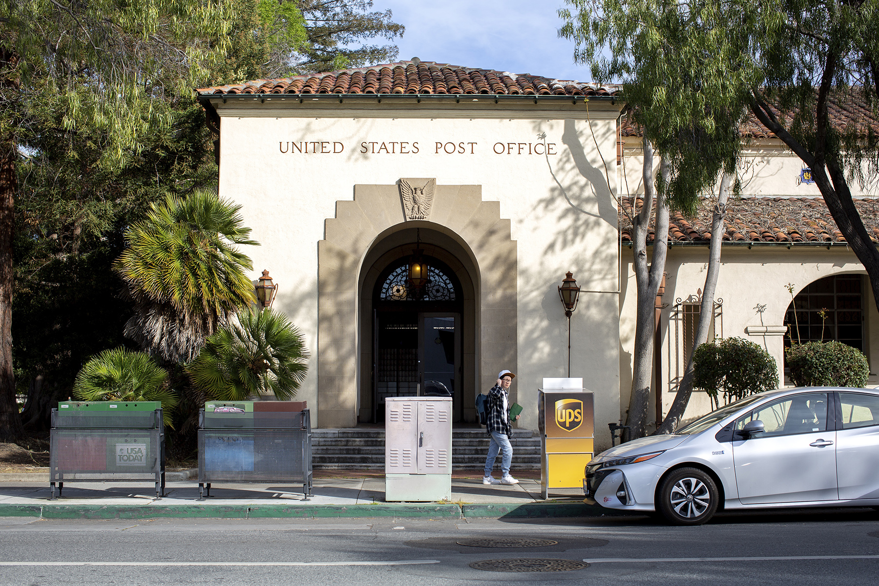 A pedestrian walks by the downtown Post Office, a historic Mission Revival style building built in the 1930s, in Palo Alto, Calif., on April, 16, 2019.