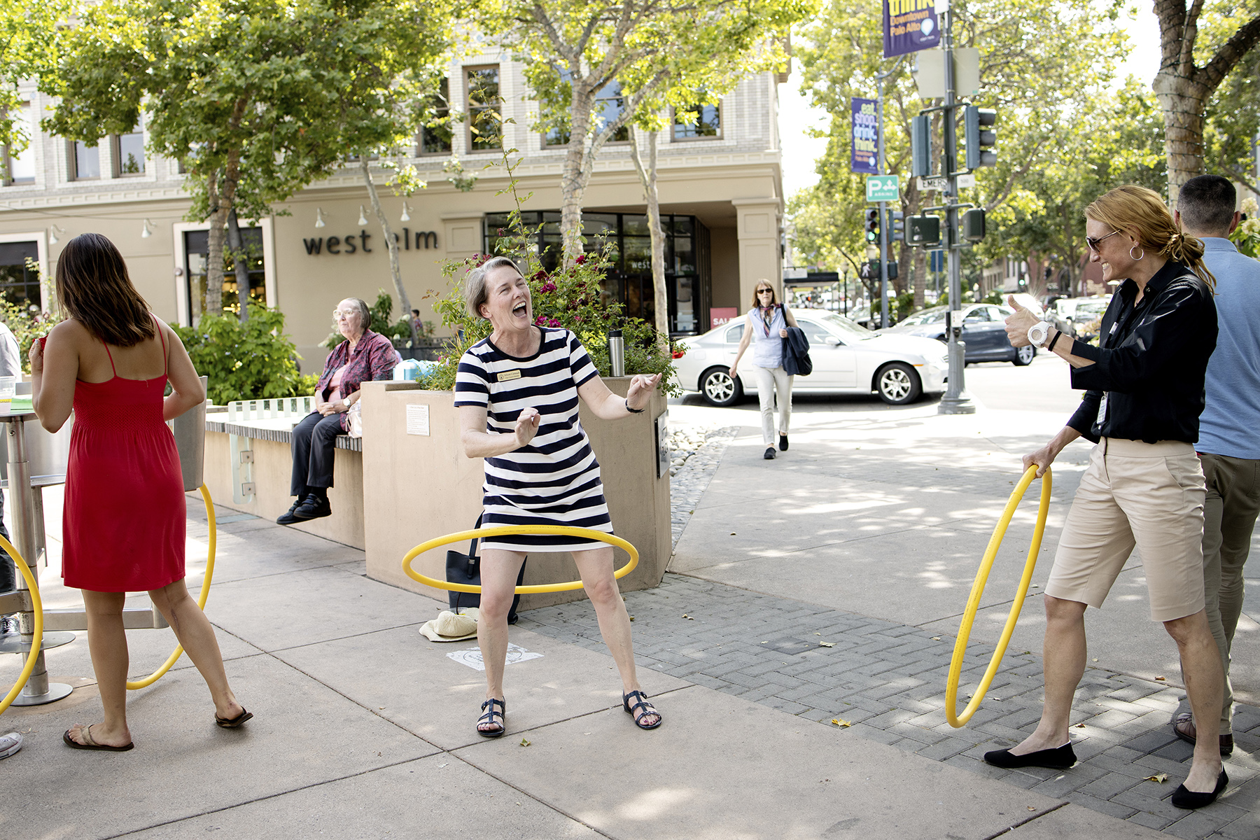 City Council Member Alison Cormack hula hoops during an event to celebrate the {quote}grand reopening{quote} of downtown after road closures at Lytton Plaza on University Avenue in Palo Alto, Calif., on June 11, 2019. Known as {quote}Upgrade Downtown,{quote} the project began in the spring of 2018 and included the installation of traffic poles and directional signs, widened sidewalks, new space for bike parking and upgrade of gas pipes, water lines and fiber cables.