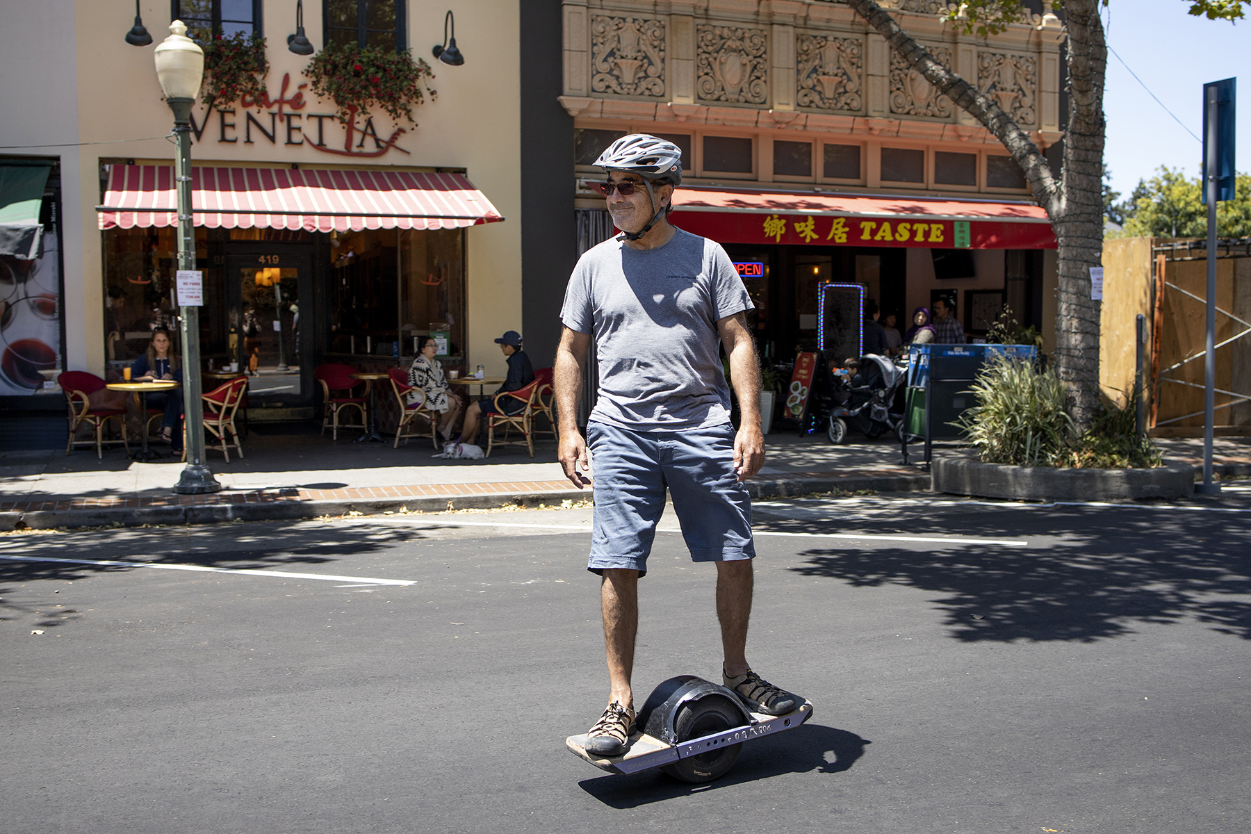 A man rides a hoverboard-like device on University Avenue during the World Music Day festival in Palo Alto, Calif., on June 16, 2019. The street was closed to traffic for several blocks for the event. This was the 11th year of the annual festival in the city, which is always held on Father's Day.