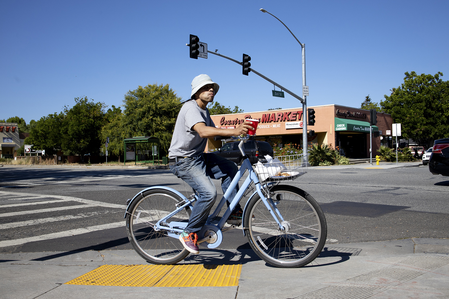 A man rides a Facebook bike along University Avenue in East Palo Alto, Calif., on June 23, 2019. The company bikes are used by Facebook employees to get around the campus, but employees often leave them around and they end up elsewhere. Outcry after police in the neighboring city of Menlo Park, where Facebook is located, stopped and interrogated people riding the bikes who they thought were not Facebook employees, led to the company issuing a statement that they didn't want anyone with the bikes stopped by police.