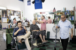 Barber Richard Reyes III (left) waits for customers at the President Barbershop in Palo Alto, Calf., on June 12, 2019. Reyes is the fourth generation of his family to work at the shop since it was created in 1949.
