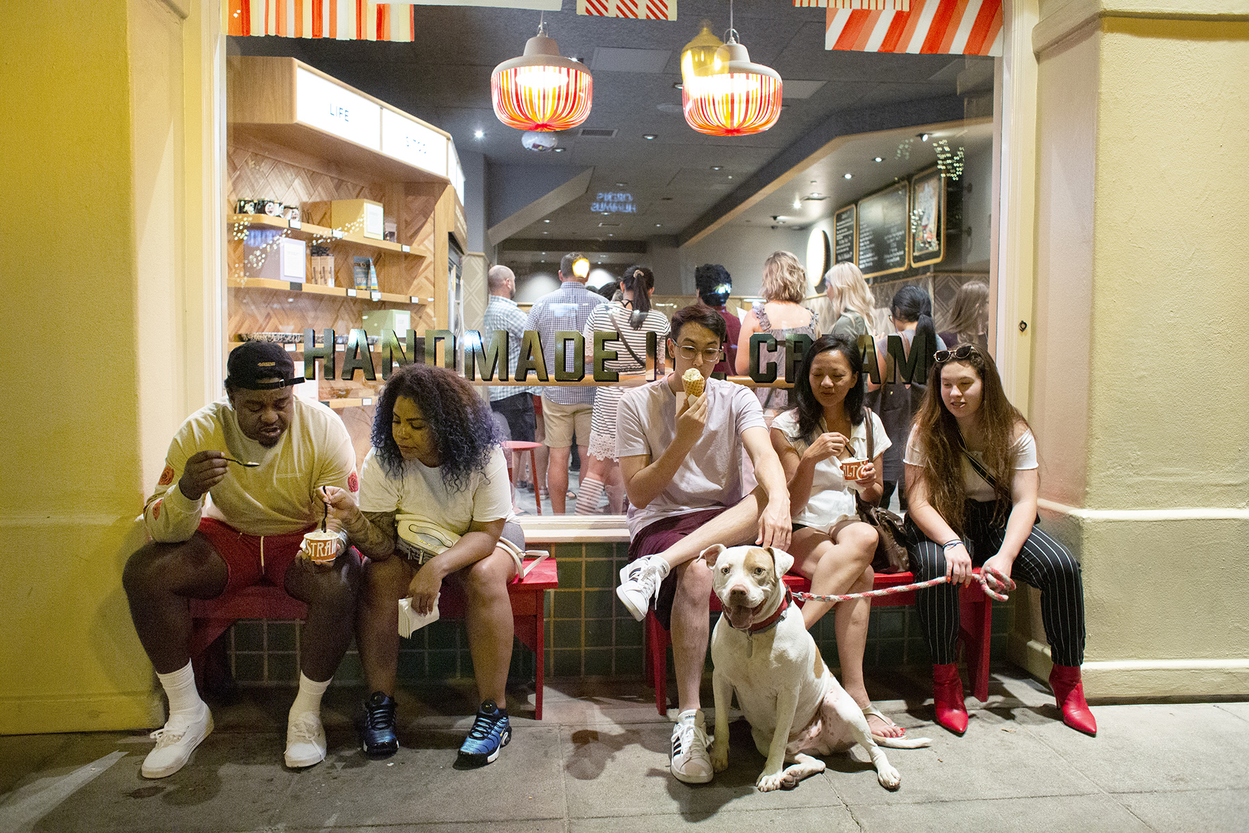 A crowd eats ice cream outside Salt & Straw, one of several high-end ice cream stores on University Avenue in the busy, bustling downtown area, during a heat wave in Palo Alto, Calif., on June, 10, 2019.