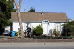 A bicyclist rides past a house on the 2200 block of University Avenue in East Palo Alto, Calif., on June 23, 2019. The medium home value in the city is an estimated $926,286 according to the real estate company Zillow. This may seem high to those outside Silicon Valley, but it is significantly more affordable than in any other city in the area, even after prices more than doubled in the past few years, sparking concerns about gentrification. According to the Silicon Valley Association of Realtors, the median home value in 2013 was $400,000.