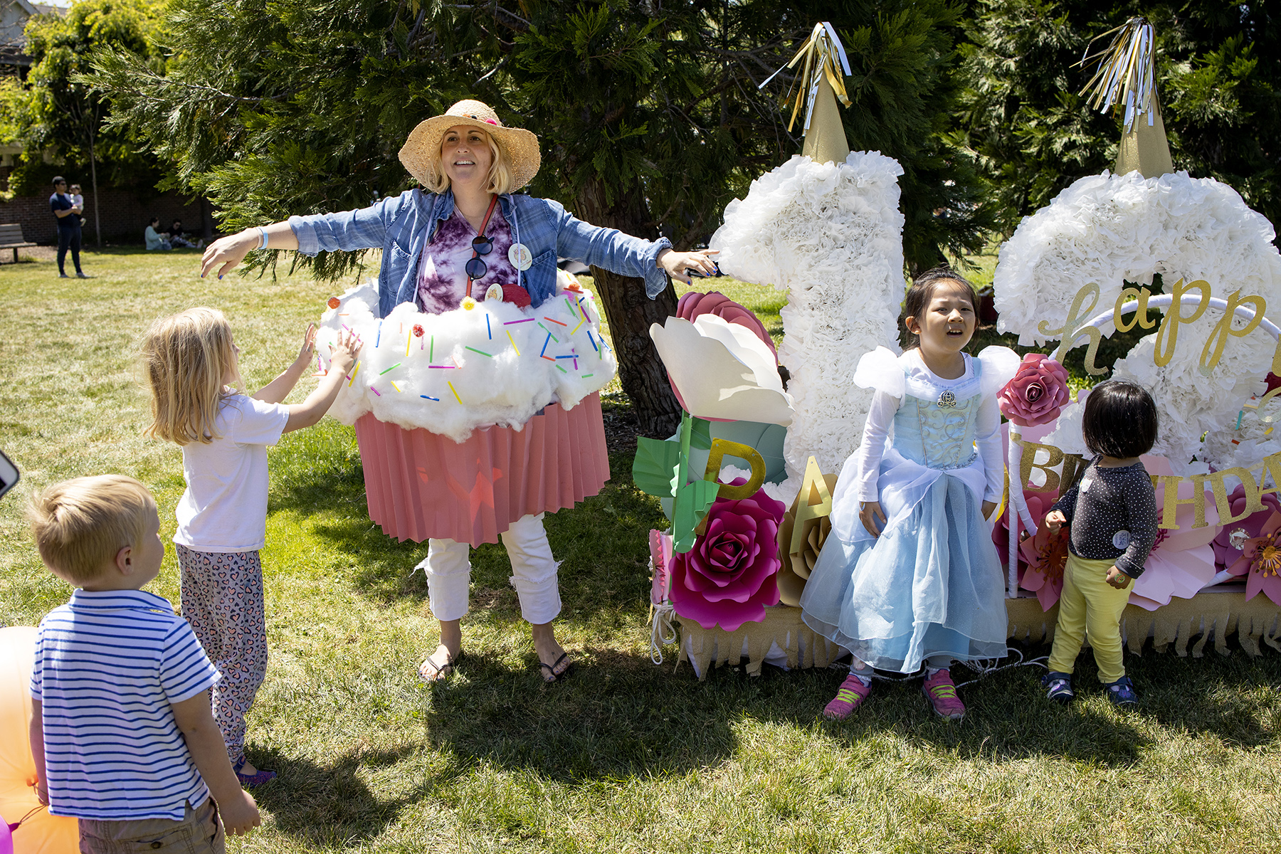 Katy Hoogendyk poses for a photograph in a cupcake costume that was made for the May Fete Parade to celebrate the city's 125th anniversary in Palo Alto, Calif., on May 5, 2019.
