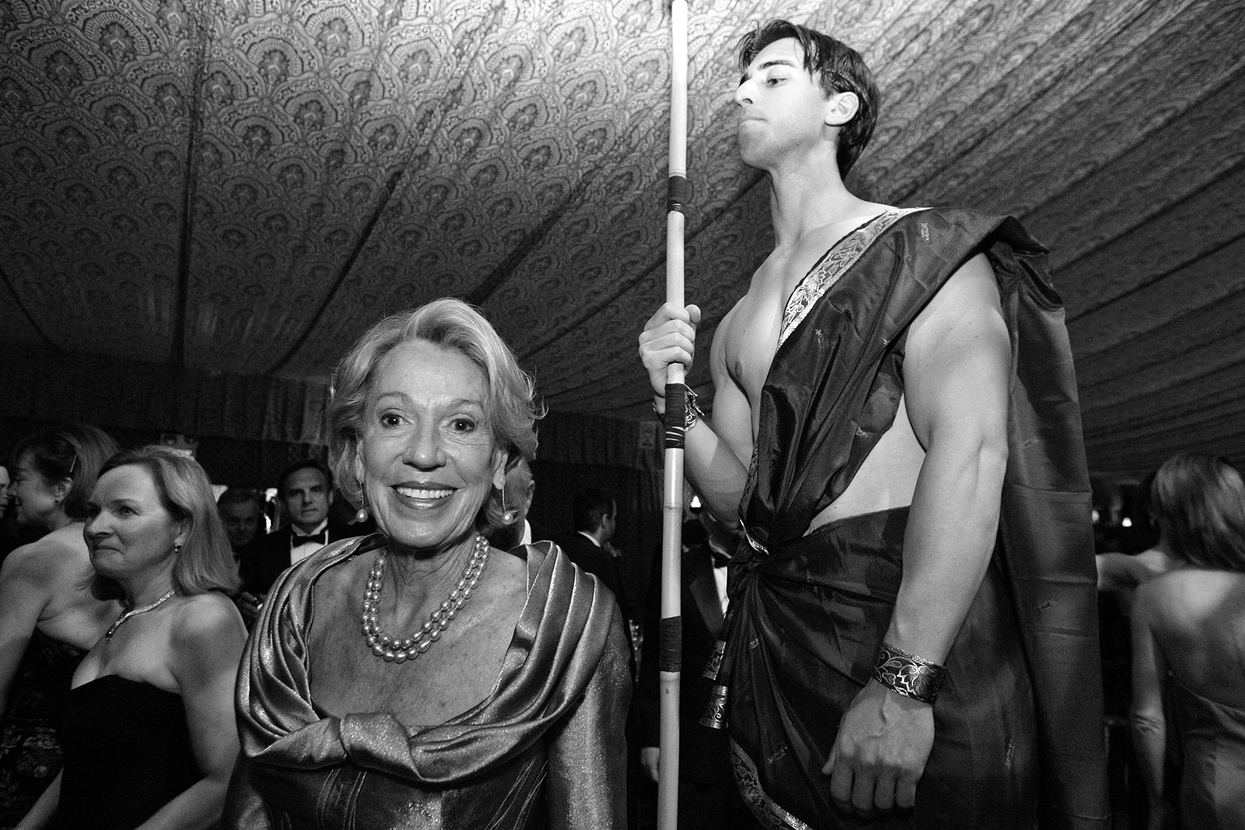 Charlotte Shultz walks past a model dressed as a temple guard from {quote}Samson and Delilah,{quote} the opera being performed that night, during the San Francisco Opera Ball in San Francisco, Calif., on Friday, September 7, 2007. The large galas to celebrate the openings of the opera, symphony and ballet and those in support of local museums are some of the most high profile parties to attend for people who wish to be a part of San Francisco high society.This photograph is of a candid moment and was not directed in any way.