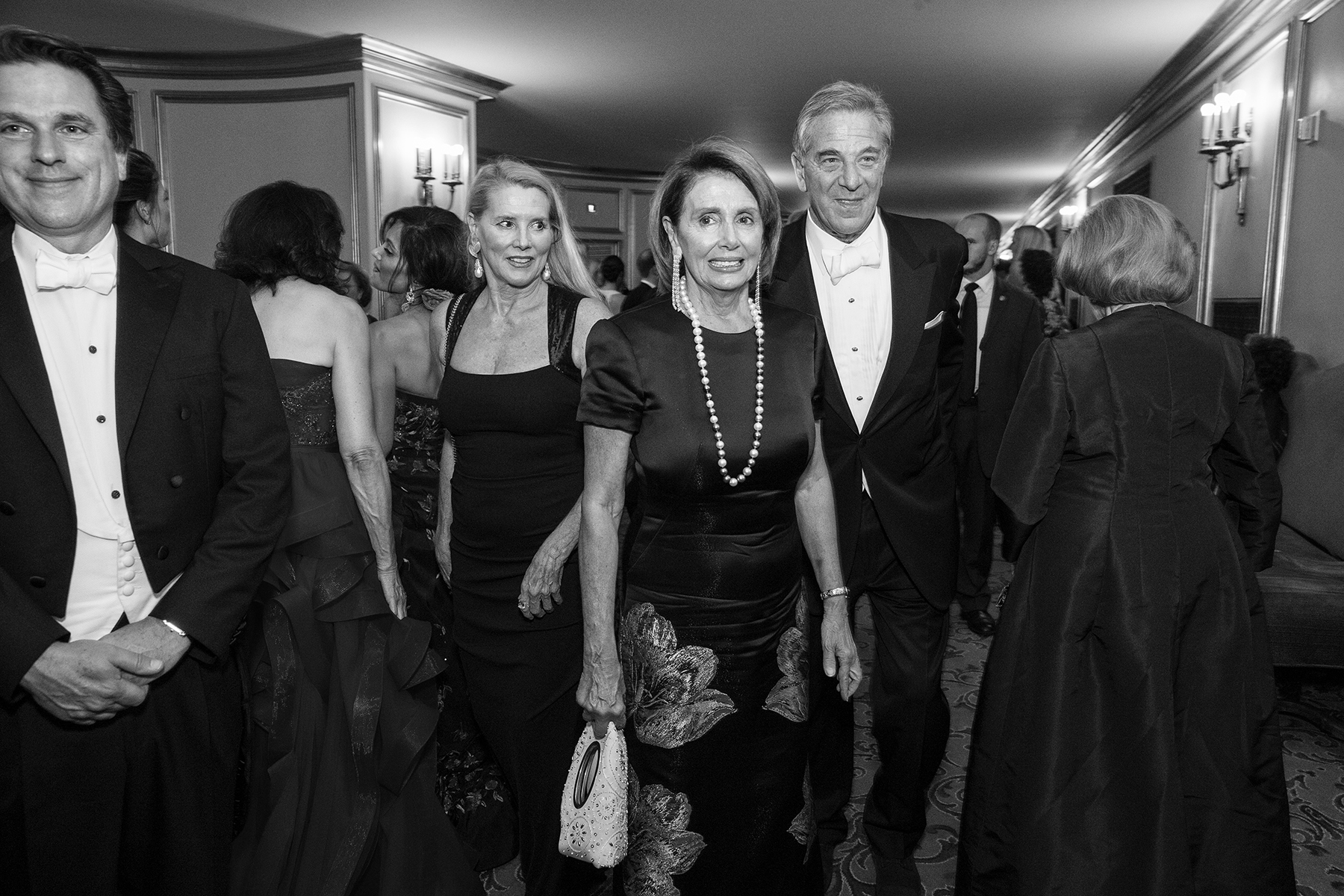 Nancy Pelosi, currently the Speaker of the United States House of Representatives, and her husband Paul Pelosi walk through the War Memorial Opera House during intermission at the San Francisco Opera Ball in San Francisco, Calif., on Friday, September 11, 2015. Pelosi represents California's 12th congressional district, which is currently entirely in the city of San Francisco. This photograph is of a candid moment and was not directed in any way.