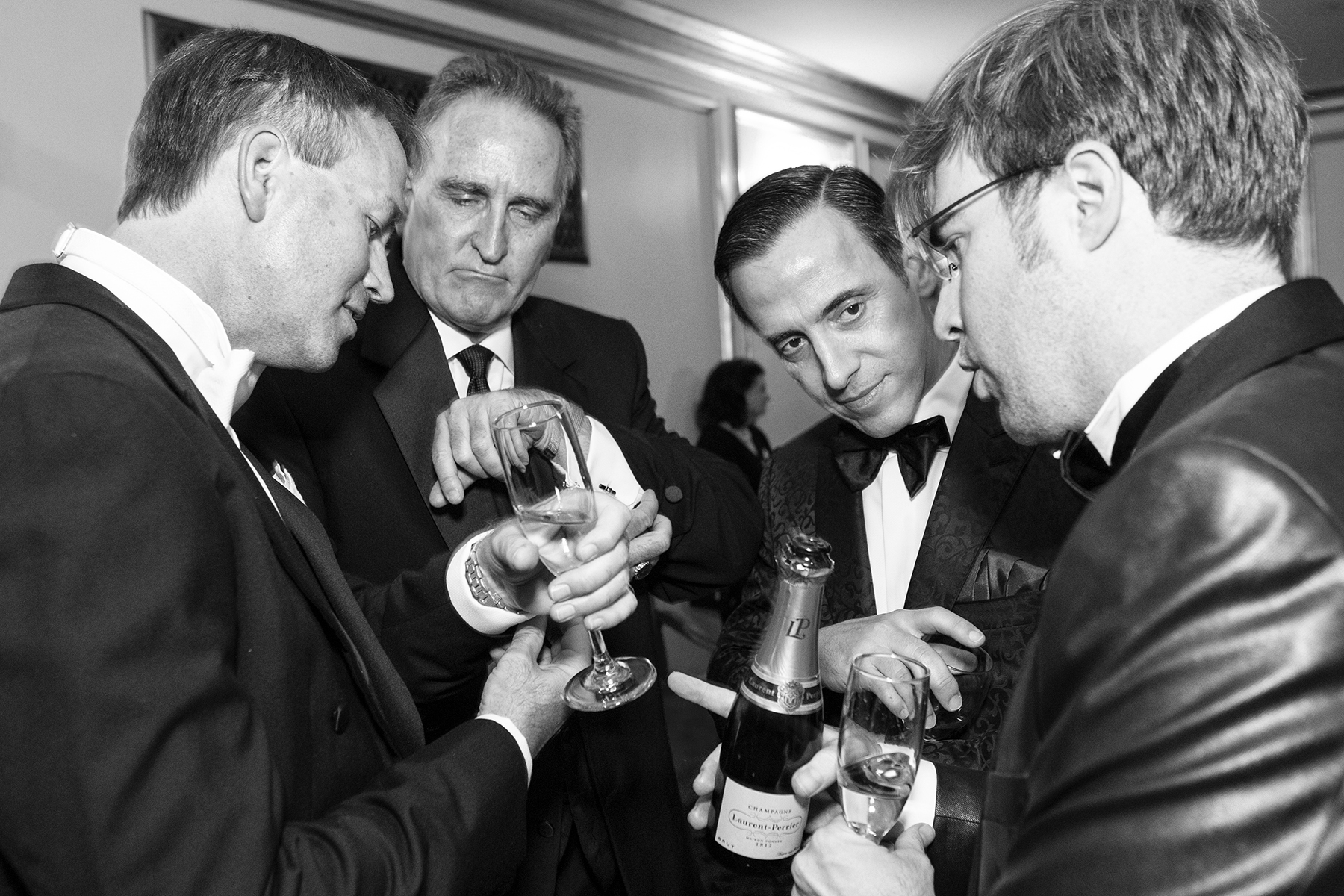 Chip Zecher, Mark Wagoner, Alan Malouf and Matthew Kimball (left to right) compare their cufflinks with one another during intermission at the San Francisco Opera Ball at War Memorial Opera House in San Francisco, Calif., on Friday, September 7, 2012.This photograph is of a candid moment and was not directed in any way.