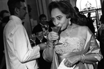Jewelle Taylor Gibbs takes a sip from her cocktail during a gala to celebrate the first anniversary of the Museum of the African Diaspora at San Francisco City Hall in San Francisco, Calif., on Saturday, March 10, 2007. This photograph is of a candid moment and was not directed in any way.