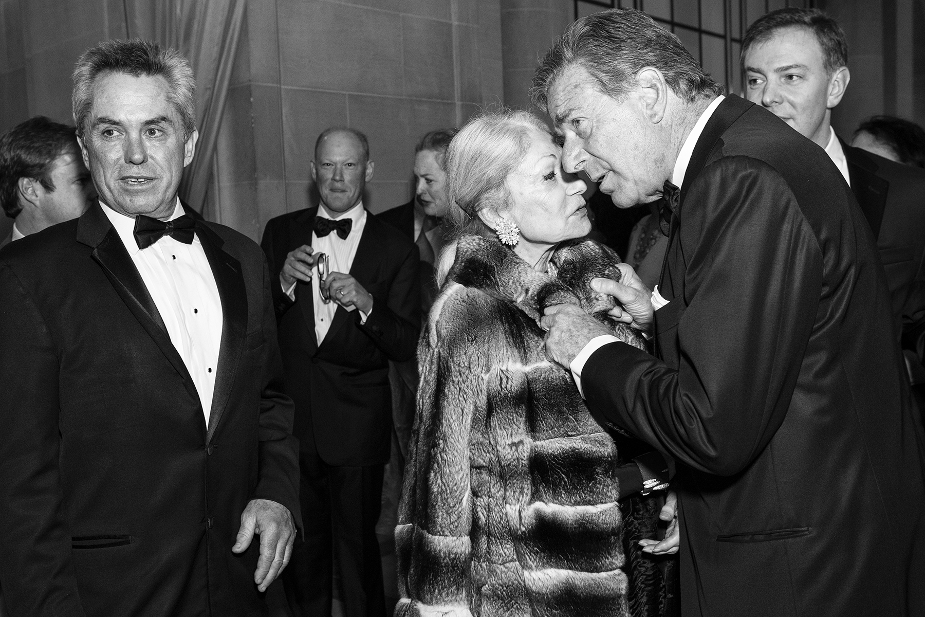 Paul Pelosi leans in to speak with socialite Denise Hale during the cocktail hour at the San Francisco Ballet Opening Night Gala in San Francisco, Calif., on Thursday, January 19, 2012. This photograph is of a candid moment and was not directed in any way.