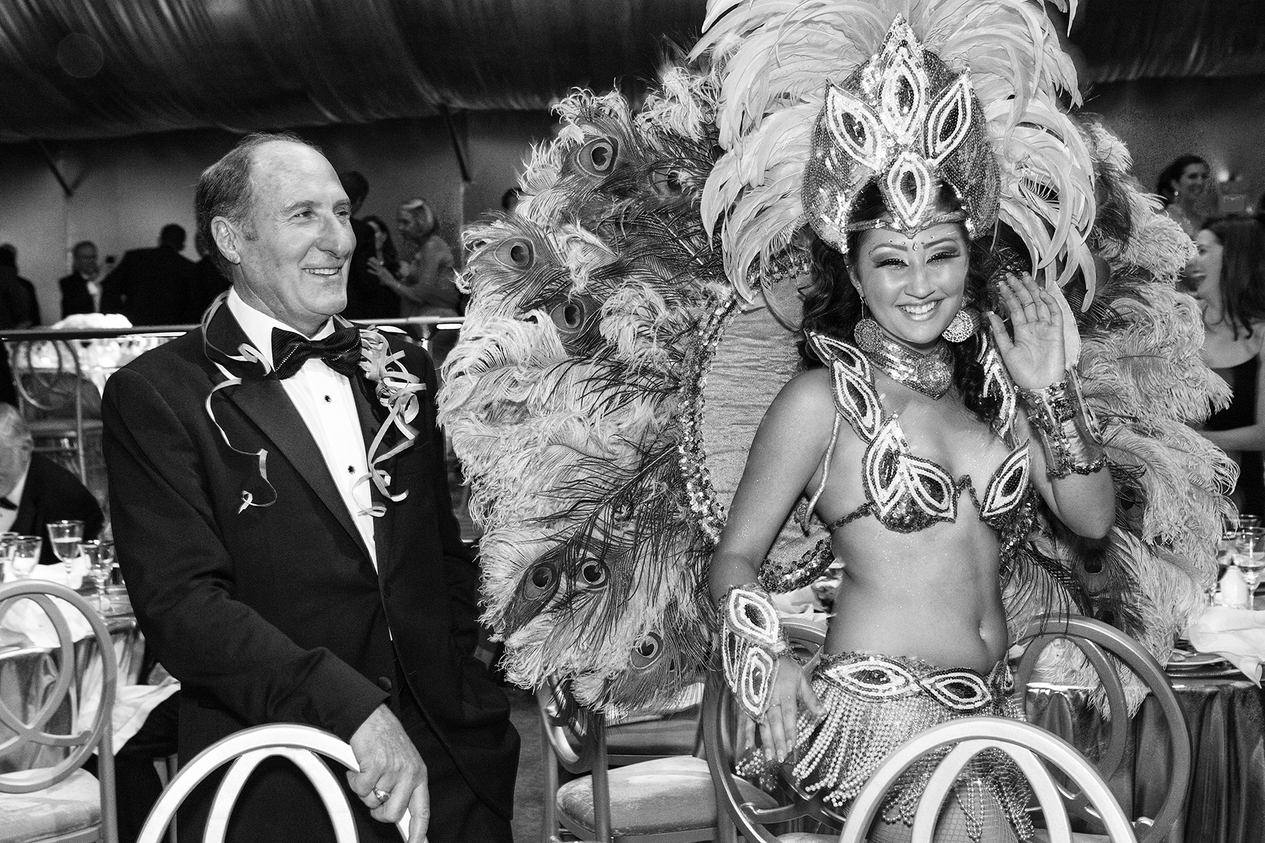 Symphony President John Goldman watches as carnival dancers dance through the patron's tent at the end of dinner during the San Francisco Symphony Opening Night Gala in San Francisco, Calif., on Wednesday, September 7, 2011. This photograph is of a candid moment and was not directed in any way.