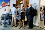 At a happy-hour event at Rothenberg Ventures, a venture capital fund that has investments in various virtual reality, drone and artificial intelligence technologies, an attendee tries on a virtual reality headset as others listen to a speaker in another room at the firm's office in San Francisco, California in July 2015. Rothenberg, which invests in early-stage technology companies with a focus on millennial founders, started River, a virtual reality accelerator program.