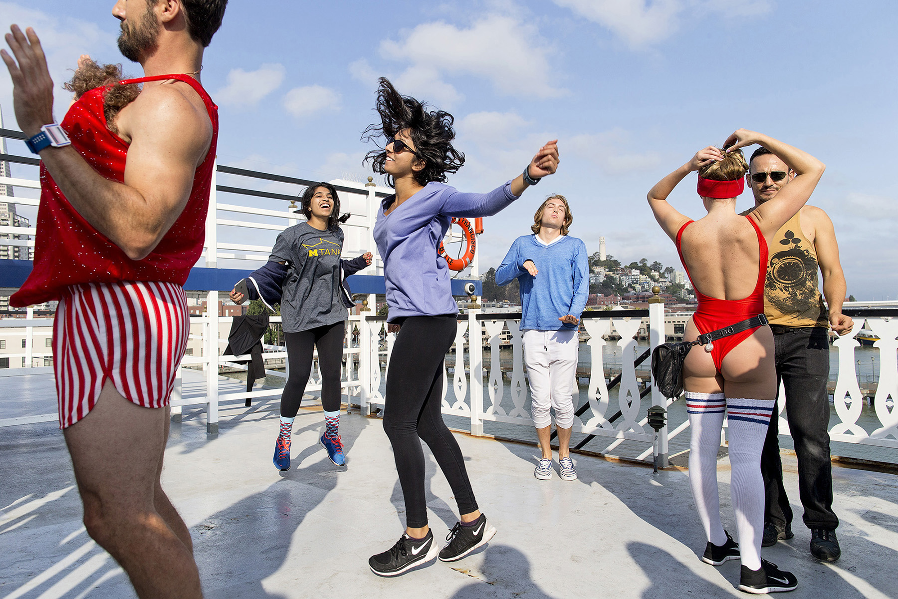 Samidha Visai, center, and Anushree Vora, second from left, dance on a cruise ship while attending an early-morning dance party called Daybreaker in San Francisco, California in August 2015. The two university students from Michigan were spending the summer in San Francisco to intern at health technology start-ups. Daybreaker events, which are substance free dance parties held early in the morning on weekdays, are very popular with young technology workers. Attendees often go straight to work from the event, energized by the dancing for the day ahead.