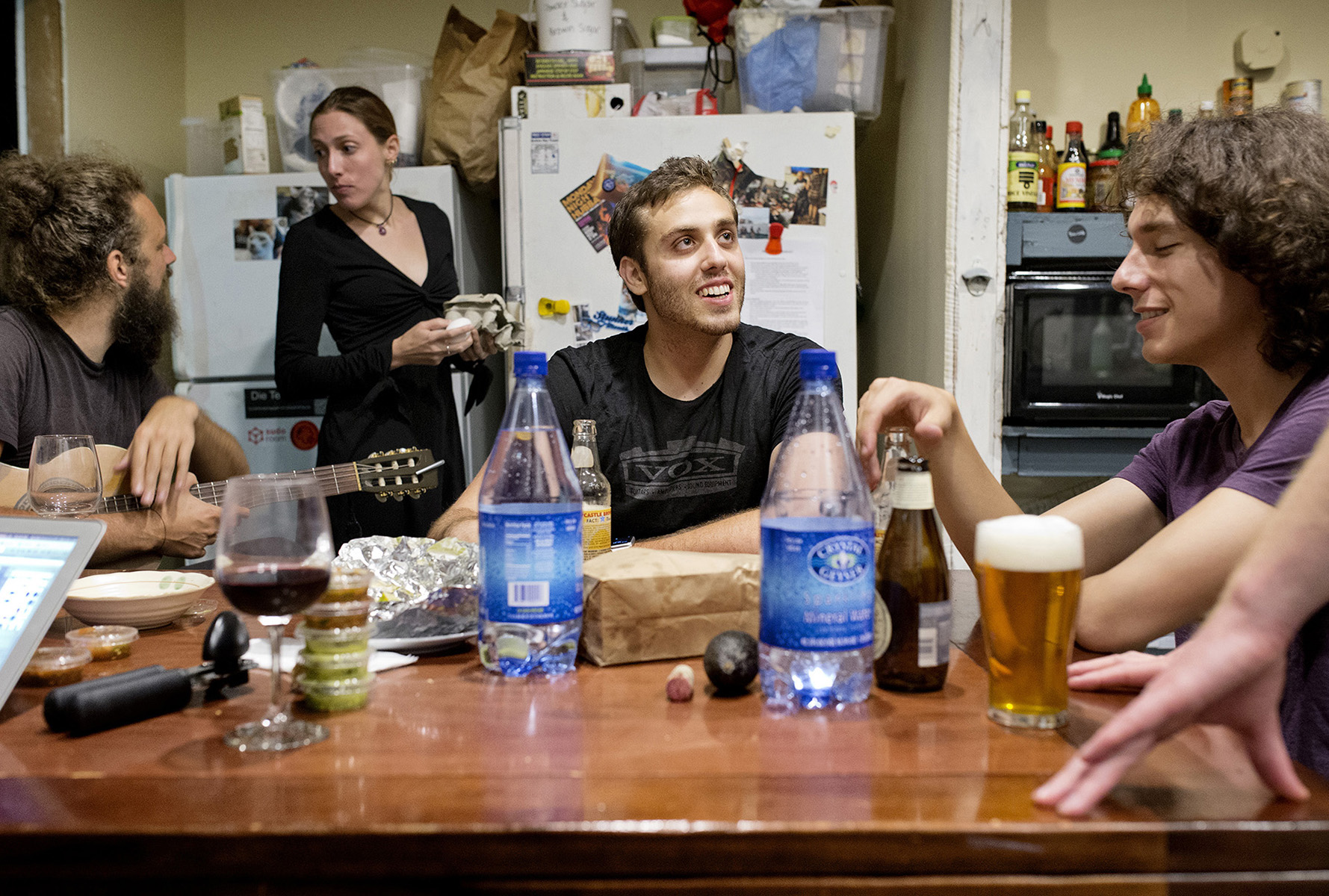 Jordan Leigh, a programmer who moved from Chicago to build a sports app, eats dinner and relaxes with his housemates in the communal kitchen at 20 Mission in San Francisco, Calif., in August 2015. The co-living movement has become very popular in the region partially as a solution to the loneliness of modern-day life, the high cost of housing and the large numbers of mostly young people to relocating to the area to participate in the tech boom. The building especially appeals to recent transplants who gain an instant group of friends as soon as they move in.