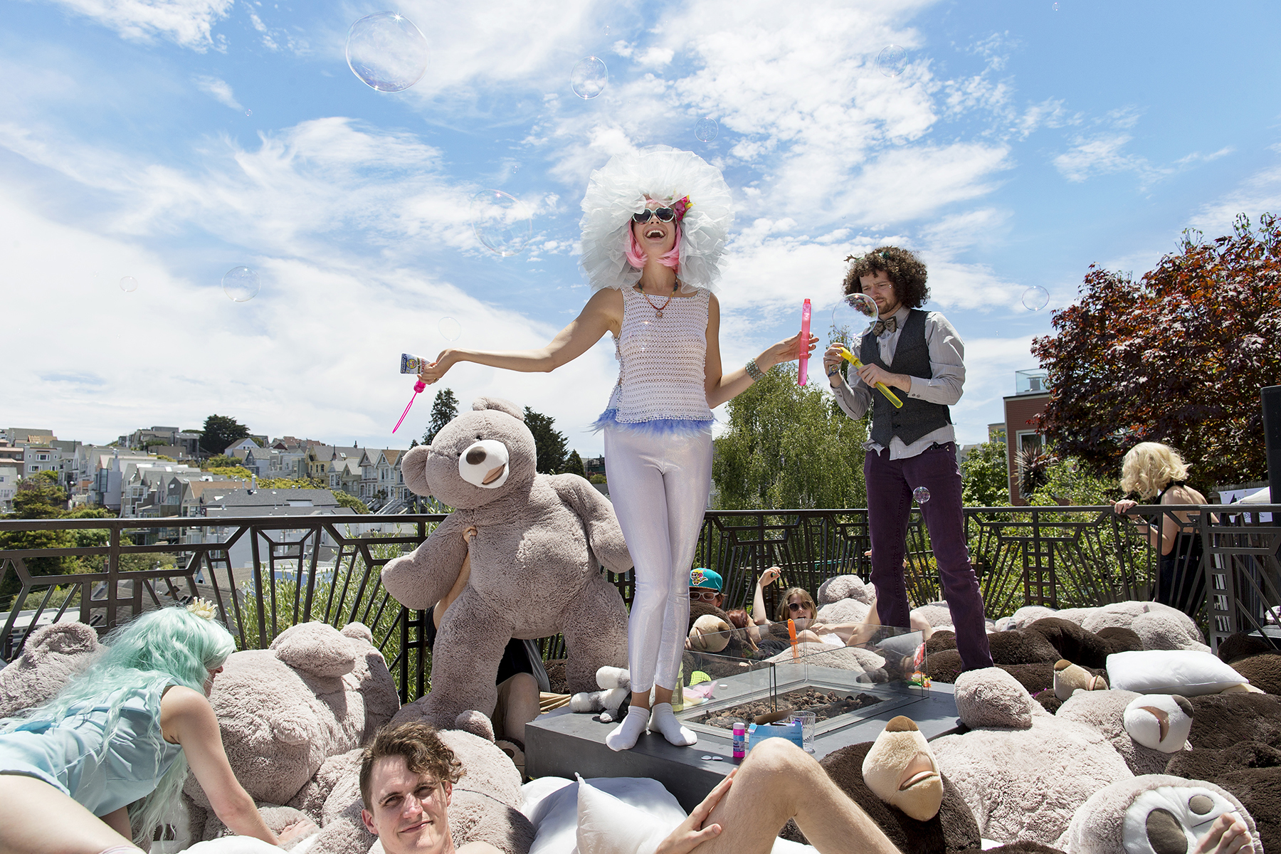 Emily Erickson (center) dances and blows bubbles during a fundraiser party for Disco Chateau, a Burning Man camp, held at the home of a technology entrepreneur in San Francisco, Calif., on Saturday, June 27, 2015. The camp members were raising money to buy more stuffed animals to bring to Burning Man. Their goal was to create a large {quote}cuddle puddle{quote} where people could cuddle with one another among stuffed animals at the annual festival. Participating in Burning Man and the culture surrounding it has become very popular within the technology start-up community.