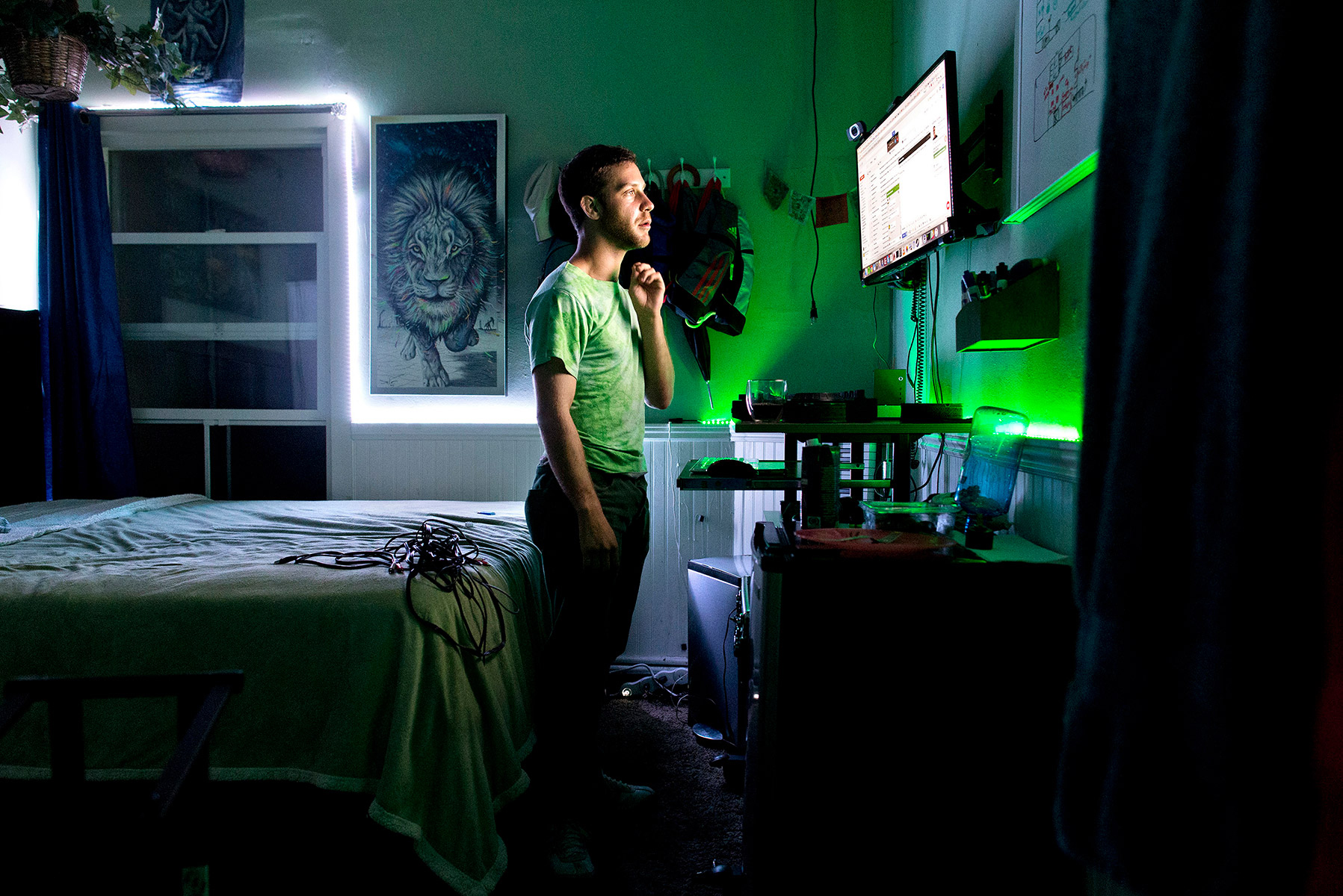 Ben Greenberg, one of the residents of 20 Mission, works in his room at the co-living community in San Francisco, California in July 2015. The space is a former single-room-occupancy hotel that had been vacant for several years before being turned into the co-living community. Greenberg is a programmer followed his passion for all things that glow and founded a start-up glowyshit.com where he sells glow-in-the-dark decorations and party supplies.