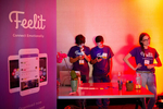 Mohammed Alkadi, Albara Hakami and Abby Wischnia, seen left to right, host a booth for their company Feelit, a social app to help people express their feelings and emotions, during the Startup and Tech Mixer at the W Hotel in San Francisco, California in March 2015. The networking event, which drew hundreds of people from the tech industry hoping to make connections, was for a time, held every few months.