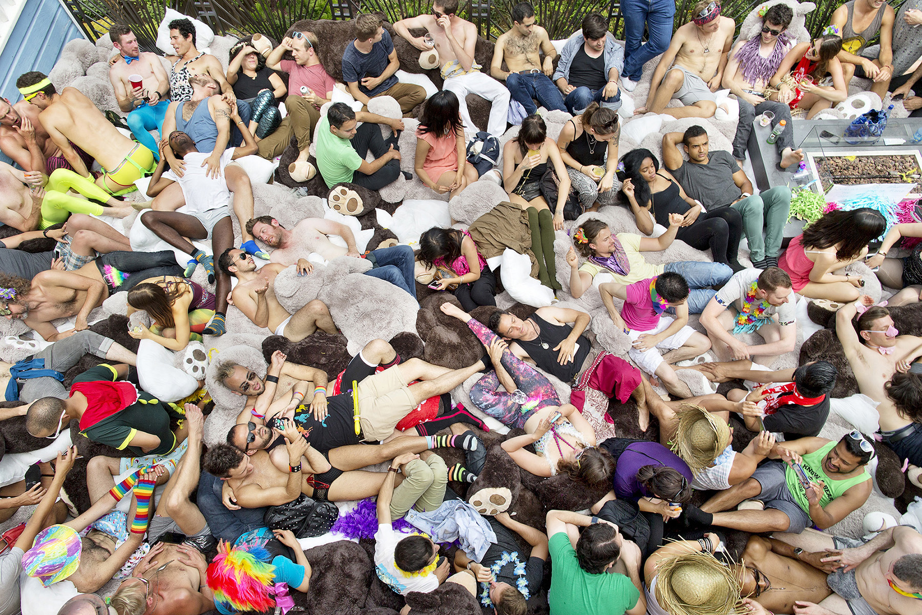 Guests of a fundraiser party for Disco Chateau, a Burning Man camp organized by technology entrepreneur Ari Kalfayan, cuddle with one another in a pile of giant stuffed animals on the deck of the home Kalfayan shares with roommates in San Francisco, California in June 2015. The camp was raising money to buy more stuffed animals to bring to the Burning Man festival for a {quote}cuddle puddle{quote} where people could cuddle with one another among the stuffed animals. The party, held during the annual San Francisco Pride weekend, also served as a pride celebration, which was made especially festive due to the Supreme Court's ruling the day before granting same-sex couples the right to marriage in the United States.