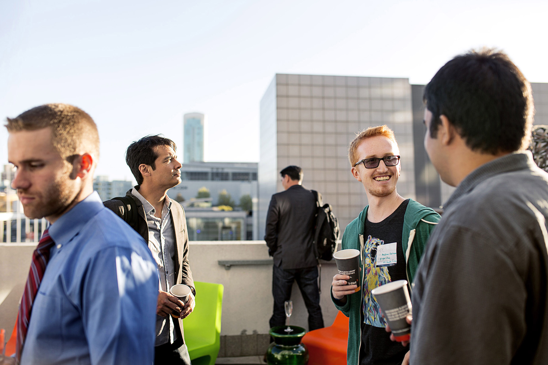 Attendees of the Startup and Tech Mixer, a tech industry networking event, mingle with one another on the roof deck of the W Hotel in San Francisco, California in August 2015. The event drew hundreds of attendees. While many companies could be built anywhere thanks to advances in technology, many entrepreneurs feel they need to be in the area to have the networking opportunities required to raise funding and build their companies.